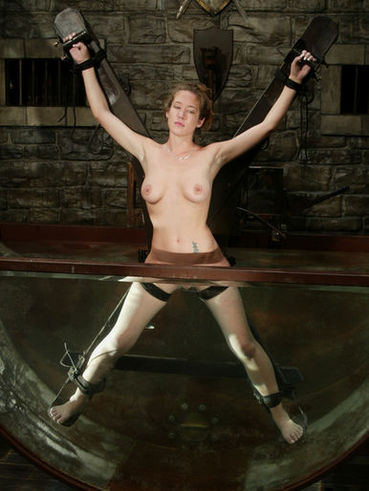 Bound slave Jade Marxxx gets her shaved pussy vibrated under the water jet