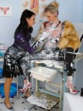 Natalli Di Rossa in fur coat and Carmen Black in satin blouse getting messy