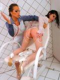 Wet blonde Mila Dark dressed in white gets her ass spanked and her muff dildoed by Gina Killmer