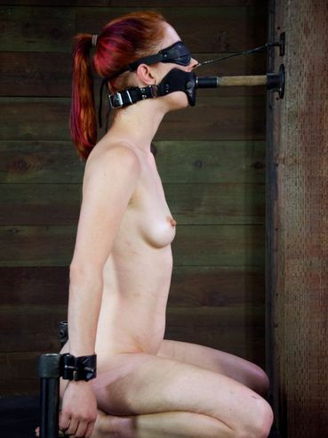 Cute redhead Calico Lane gets a mask on her face, and all of her holes and nipples are pinched.