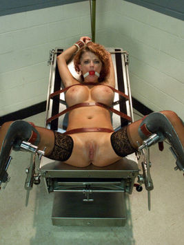 Wicked milf Joslyn James with red hair and big tits gets tied to the chair and fucked by two studs