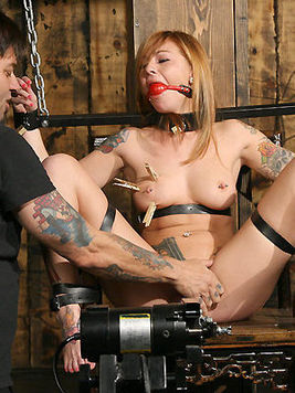 Master Liam is curious about how much pain loving slave girl Scarlett Pain can take