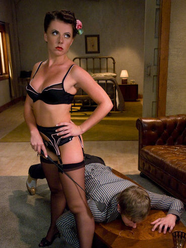 Domina Penny Flame in black lingerie rides hard cock of her slave Daniel after punishment
