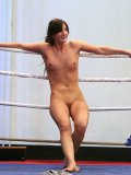 Naked shaved lesbian fighters Demi C and Colette W. play with snatches and assholes of each other
