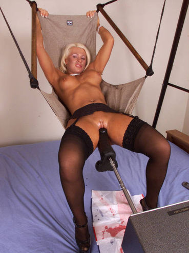 Busty stocking blonde Melissa Dettwiller gets fucked by big black power dildo in a swing