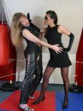 Two aggressive women dressed in black Joy and Dona Lucia get their fight started