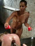 Nude domina Isis Love uses cold water and hot candle wax to torture blonde Vendetta
