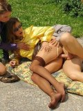 Rachel Evans and one more leggy clothed slut get fucked in the sun and get pissed on