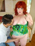 Plump big titted redhead woman Dawn Davenport takes off her green dress and gets nailed