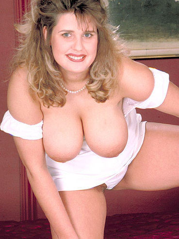 Thick lady Gabi poses in white making no secret of her amazing big tits