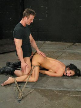 Big titted rope tied brunette babe Mason Moore gets raised off the ground and banged