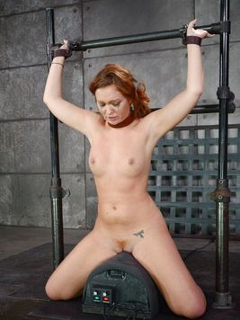 While on her knees during BDSM, chained up and gagging Maddy OReilly gets deep-throated and fucked.