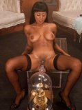 Beautiful ebony girl Ezanni Solei likes it when the sex machine is drilling her really roughly.