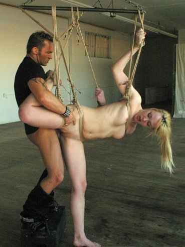 Submissive blonde Annette Schwarz gets her bald pussy and ass fucked after tit torture