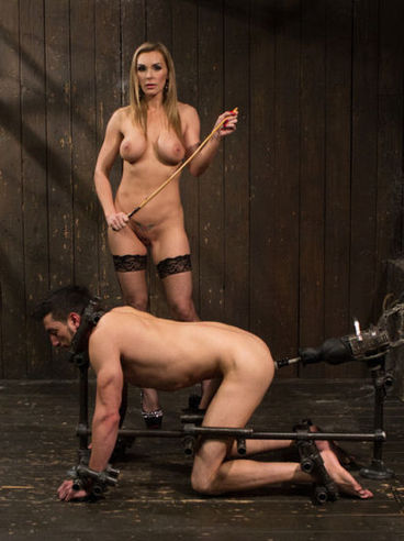 Pretty blonde Tanya Tate puts a box on her slave's head and makes him lick her throbbing clit.