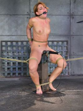 Red haired babe Savannah Fox gets tied up and is hardcore stimulated by her BDSM master.