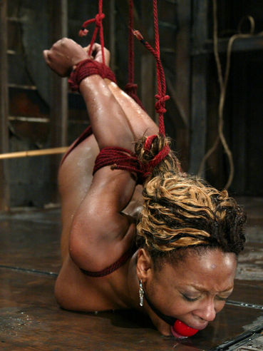 Dark skinned slave girl Vixen Fyre gets tied up, gagged, tortured and finally dunked