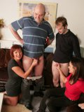 Wendy Taylor and friends compare dicks of two men in the middle of the living room