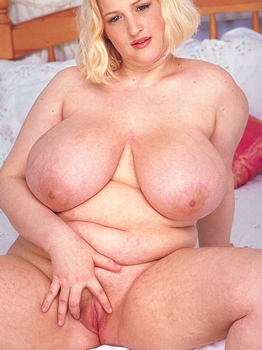 Lovely chunky blonde Gemma Field with giant tits and shaved snatch stripping naked