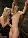 Blonde fetish babe Cherry Torn tormenting and molesting Mona Wales until she screams in pleasure.