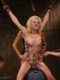 Blonde and pegged babe Ally Ann in a bizarre situation while teased and stimulated by kinky babes.