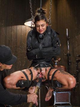 Tattooed Bonnie Rotten screaming out in bondage pleasure and sweet pain while chained to a post.