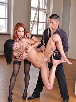 Red-head Amarna Miller and fetish loving Meg Magic on the floor getting licked and bondage fucked.