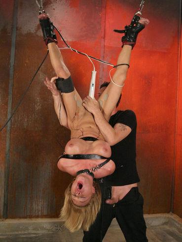 Beauty Krissy Lynn is hanging head over heels when her master is enjoying her body.