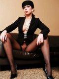 Leggy brunette milf Stella Van Gent in pantyhose poses topless and exposes her big hooters