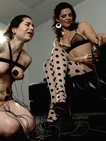 Bobbi Starr hooks up her BDSM slave girl Nadine Sage to some electricity for bondage action