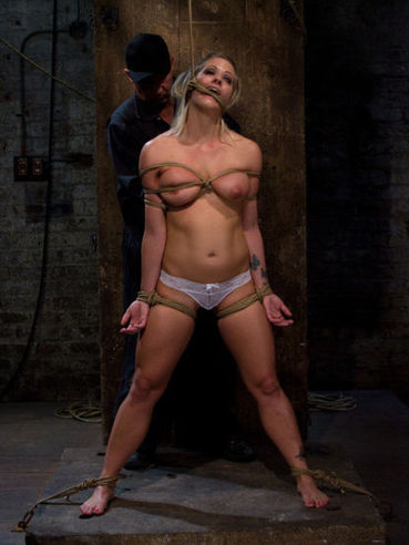 Blonde Holly Heart with shapely juicy tits and smooth pussy put in rope bondage