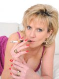 Lady Sonia loves to smoke in front of the camera and show off her hot body.