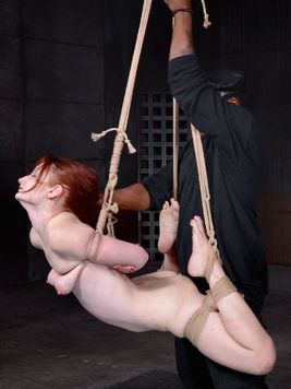Red haired Violet Monroe poses before getting her pale body ties and stretched in dirty bondage.