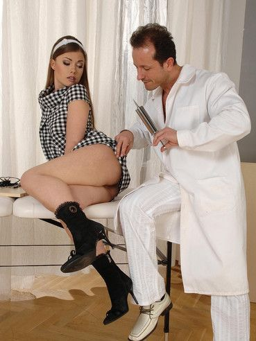 Doctor inserts speculum in Johane Johanson's anus and examines her black anal tunnel