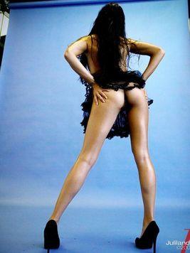 Brunette pornstar Michelle Maylene demonstrating long legs up the short skirt