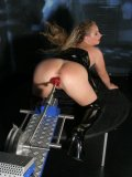 Firm ass Katja M with tight hairless pussy get dildoed doggy style by fucking machine