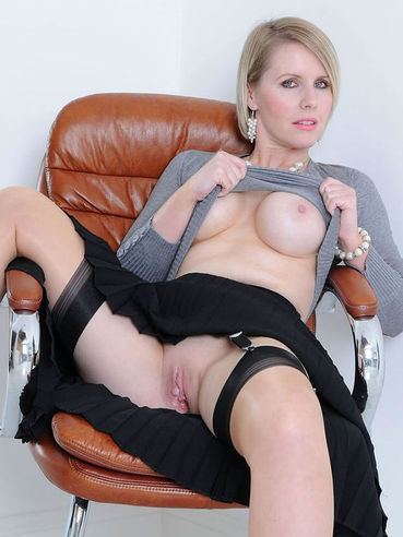 ELegant mom Angela in sexy stockings bares her smooth pussy and perfect big jugs.