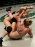 Bella Wilde and Lea Lexis are half naked on the floor while wrestling in kinky cat fights.