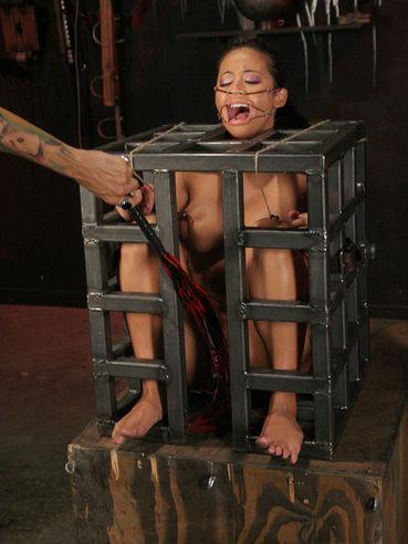 Sir Nik punishes enslaved Mia Lelani in the cage and on the bondage table