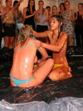 Lora Licious loses her bikini as well as her opponent in oil wrestling match