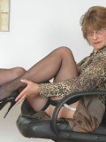 British mom Anna J in nylon stockings and high heels shows off her sexy slim legs
