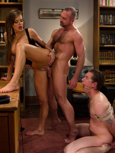 Busty Nika Noire makes her slaves Josh West and Vern Hopkins fuck her pussy after strapon fuck