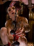 Tattooed small titted mistress Simone Kross in latex dress gives pain to her slave Simone Kross