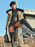 Stella Van Gent in high boots loves long fur coat and short leather dress