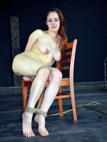 Hogtied naked slave girl Iona Grace finds her asshole filled with butt plug