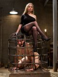 Bondage mistress Aiden Starr humiliating and making her caged man-slave crawl and beg.