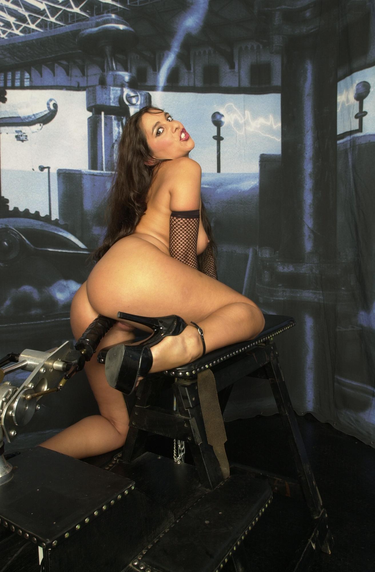 Black haired bitch Salma de Nora enjoys black robotic ...