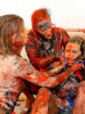 Miss Piss, Victoria Rose and Dionne Darling paint each other on the floor just for fun