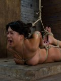 Oriental brunette Kayme Kai with sexy shapely boobs finds herself in hogtie bondage