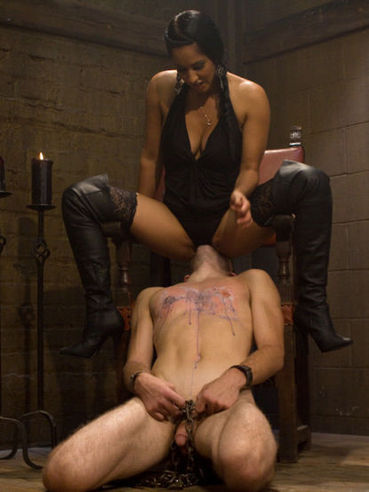 Beautiful domina Isis Love ties up her slave, rides him and then nails him in the asshole.